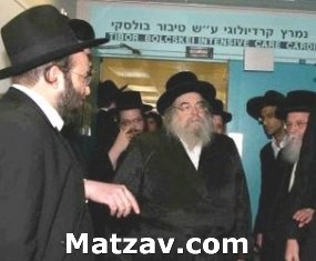 The Belzer Rebbe arriving at Shaarei Tzedek Medical Center.