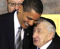 President Barack Obama hugging a Holocaust survivor at the Holocaust remembrance ceremony.