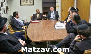Members of today's Agudath Israel delegation to Albany, conferring with State Senator John L. Sampson.