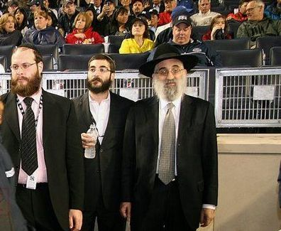 Rabbi Don Yoel Levy (R) of the OK.