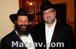 Rabbi Pinchos Lipschutz (R) with his chavrusah and friend, R' Shalom Mordechai Rubashkin, as they meet for the first time last Friday in Postville, Iowa.