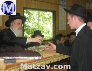 """Motty Borger z""""l (R) with the Munkatcher Rebbe shlit""""a."""