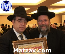 Yanky Arem with Rav Moshe Tuvia Lieff and the proclamation signed by Rav Aharon Leib Shteinman naming Mr. Arem as Chairman of the Executive Board of P'eylim / Lev L'Achim.