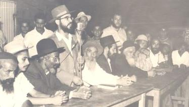 A Young Rav Lifschutz with Yemenite immigrants.