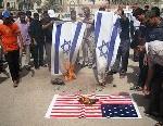 protetsors-burn-israeli-american-flags