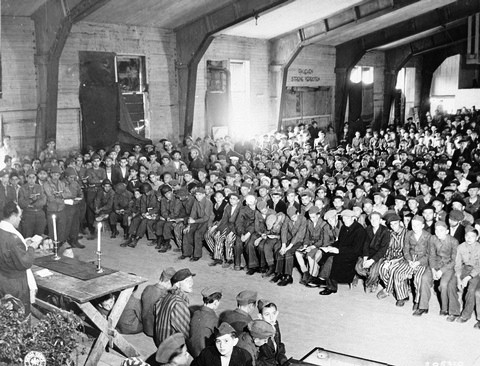 Rabbi Hershel Schaecter leading the davening on the first day of Shavuos for Buchenwald survivors shortly after liberation.