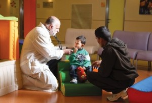 dr-david-mishali-with-young-syrian-heart-patient