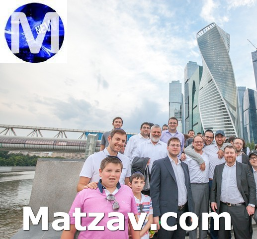 Akiva Medjuk and Shmuel and Shmuel Medjuk with the group in front of Moscow City business park