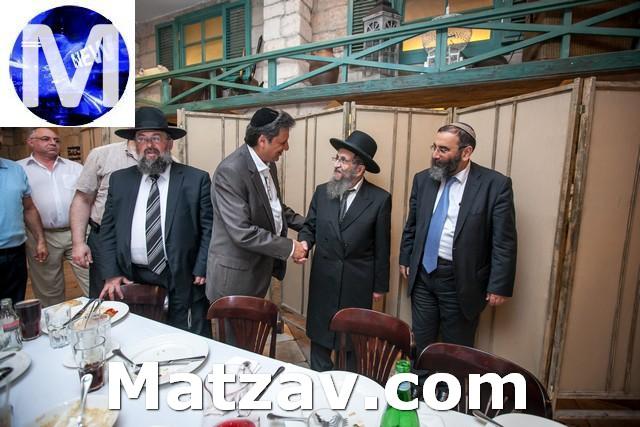 Eliyahu Dabakarov greets the Rosh Yeshiva