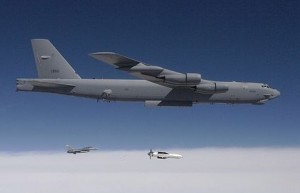 A B-52 bomber releases a Massive Ordnance Penetrator, a 30,000-pound bunker buster bomb