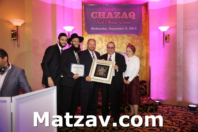 (L-R) Yaniv and Rabbi Ilan Meirov along with Councilman Rory Lancman presenting the Chazaq Community Service Award to Mr. and Mrs. Manny Behar