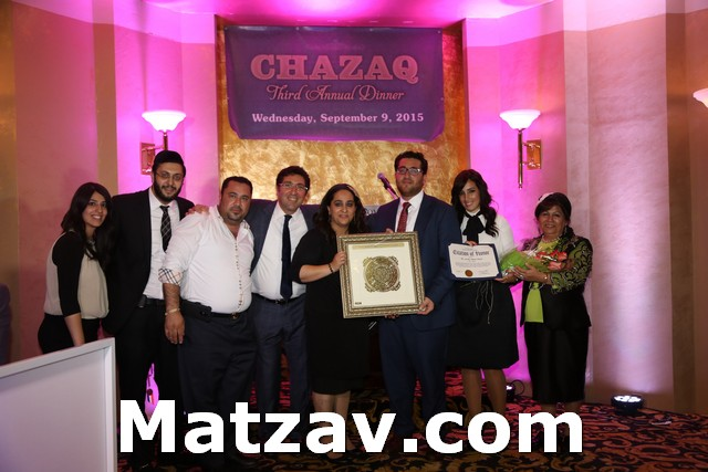 Mr. and Mrs. Moshe Sdayeb and family receiving the Chazaq Hakarat HaTov Award