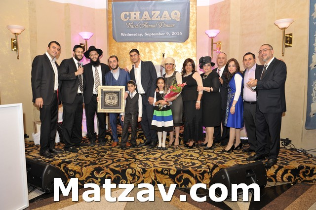 Mr. and Mrs. Robert Gurgov and family receiving the Chazaq Pillar of Chesed Award