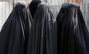 Burqa-clad women arrive to see off their relatives who are leaving Ahmedabad for Mecca in Saudi Arabia to attend the annual religious Haj pilgrimage