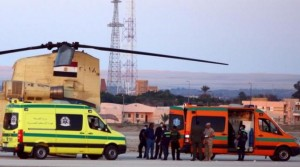 Egyptian army with police and rescue crew transfer bodies of victims of a plane crash, from a civil police helicopter to an ambulance at Kabrit airport in Suez