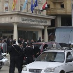 Police are seen at the scene where gunmen attacked a tourist bus in front of a hotel in Giza