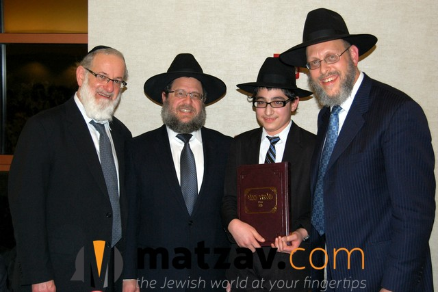 Rabbi Moshe Berger, Rabbi Ephraim Levi and Rabbi Hillel Drazin presenting awards