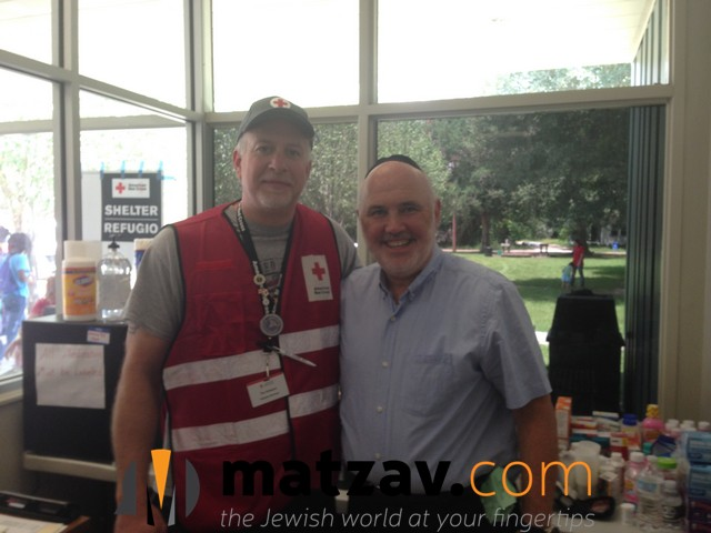 Rabbi Ten with ARC volunteer (2) in S. Louisiana flood area.