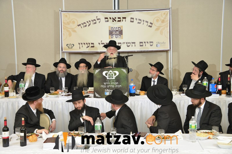 rav-elya-ber-wachtfogel-delivering-remarks-at-the-bmg-chaburas-dirshu-siyum-hashas-a